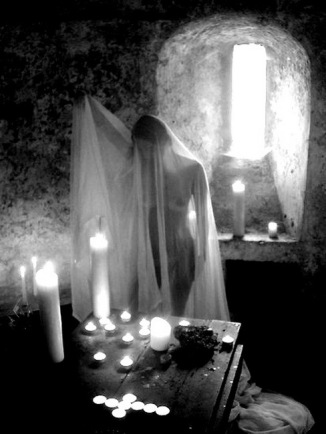 window-candles-woman